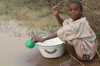 Child fetching dirty water